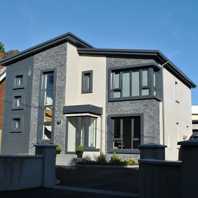 Black Slate Wall Cladding on various sections of modern home.jpg