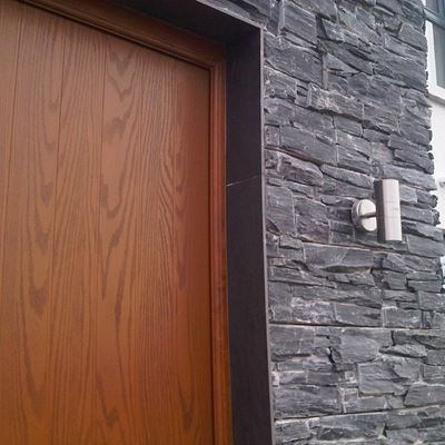 Black Slate wall cladding with natural slate door surround.jpg