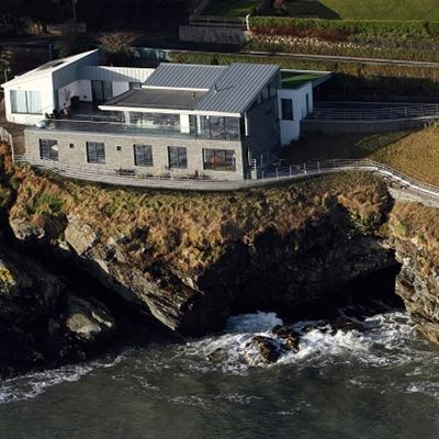 Aerial view of house cladded with Black Slate Z Stone on the coast.jpg